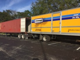 The Penske truck with a lift was the same height as the container floor, allowing us to easily walk items from the truck to the container.