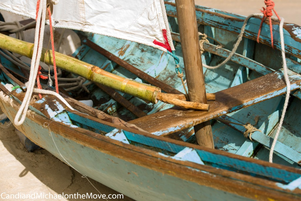 This is a great shot showing the condition of the average work boat and their makeshift masts. This is a very typical set up with bamboo booms.