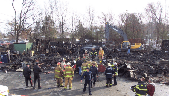 Firefighters at the site of the Station Nightclub Fire which took place on February 20, 2003.