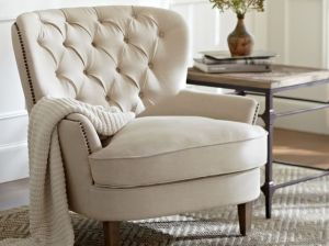 CARDIFF TUFTED UPHOLSTERED ARMCHAIR with NAILHEAD TRIM. Pottery Barn