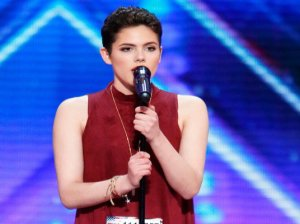 """See 16 year old cancer survivor Calysta Bevier of Grand Rapids, Ohio wow the crowd and the judges with her amazing performance! I loved her cover of Rachel Platten's hit song """"Fight Song."""" Her standing ovation was well deserved! She is such an inspiration to everyone. Simon Cowell used his golden buzzer on her. She is headed straight to the live shows!"""