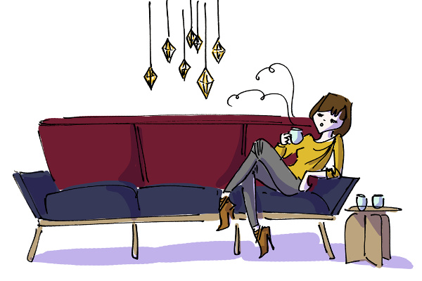 Girl drinking tea on a Hamm couch