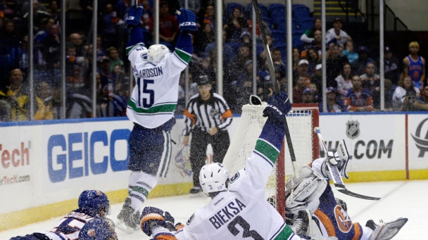 Brad Richardson of the Vancouver Canucks scores the OT winner against the New York Islanders.