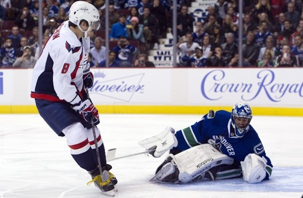Roberto Luongo of the Vancouver Canucks stops Alex Ovechkin of the Washington Capitals on a penalty shot.