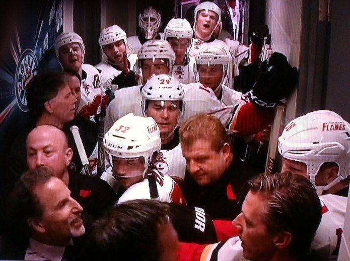 John Tortorella tries to get into the Calgary Flames dressing room.
