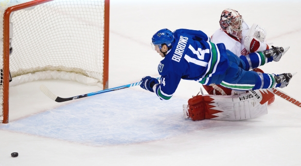 "A summary of Burrows' ""puck luck"" summed up in one picture. Puck drop is 4:30 pm/pst tonight against the Detroit Red wings at Joe Louis Arena.  (Photo courtesy of vancouversun.com)"