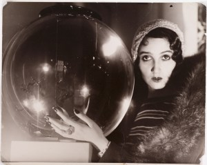 "The Crystal Ball (La Boule de Verre),"" 1931. Jacques-Henri Lartigue (French, 1894–1986). Gelatin silver print, toned; 23.7 x 29.9 cm. The Cleveland Museum of Art, John L. Severance Fund 2007.149. Photograph by Jacques Henri Lartigue © Ministère de la Culture - France / AAJHL."