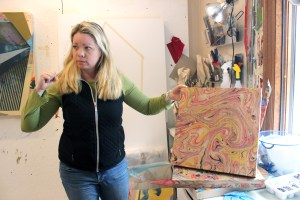 Jenniffer Omaitz discusses her marbling – a creative endeavor she undertakes in her spare time – while in her studio in Kent.