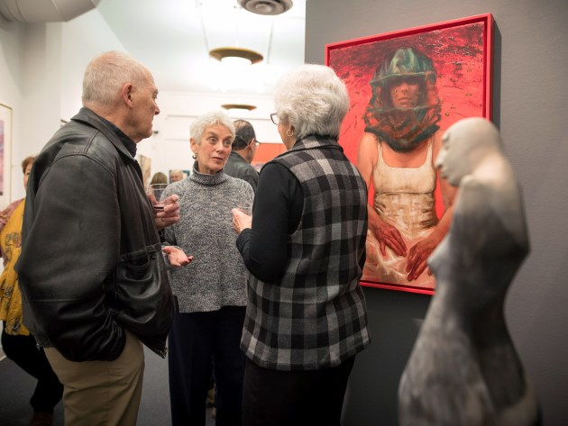 "From left, George Roby talks with Sally Zarney and Ellie Wren during the ""It's Elemental: Fire & Water"" exhibit, which was on view in early 2017 at the Valley Art Center. Photo by Valley Art Center / Michael Steinberg"