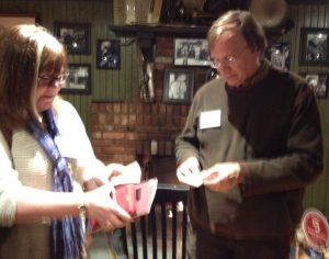 Lawrence Kessenich signs a book for a new fan.
