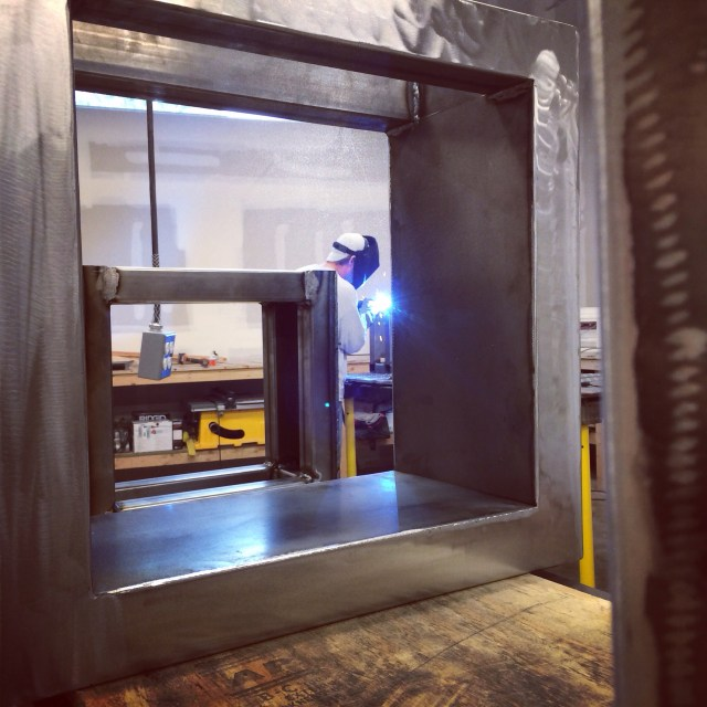 Welding the steel.
