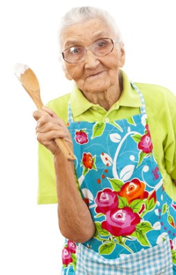 senior female cooking 253x396 Dementia Activity and Communication Tips