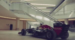 Red Bull F1 car cruises through Yas Mall