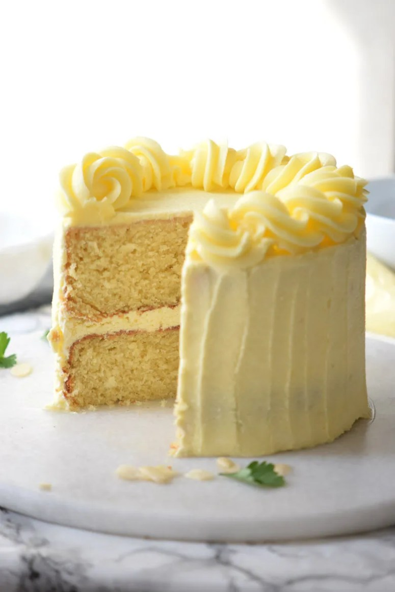The very best Vanilla Layer Cake you'll ever bake! This is so good I'm seriously thinkign about using it as my wedding cake. Moist, packed with flavor and great to frost! This is seriously the best vanilla layer cake recipe ever!!