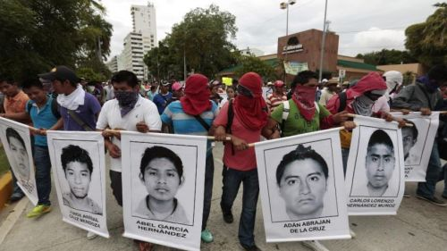 Photo courtesy AP/Eduardo Verdugo: Protest marchers show faces of the missing, Acapulco, Oct 2014