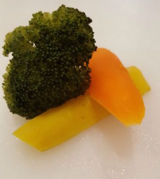 Yes, these are broccoli and rainbow carrots, cooked and tender.
