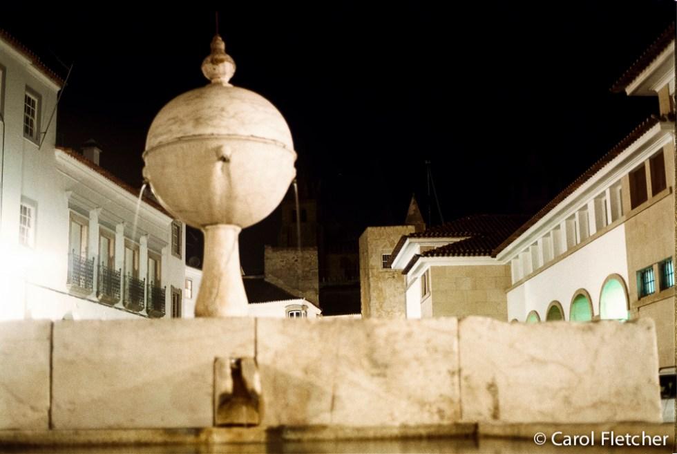 Largo da Porta de Moura's marble fountain in Evora