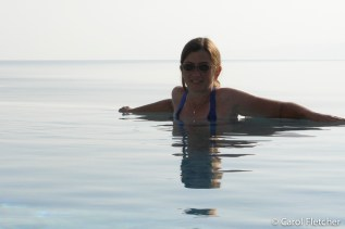 Carol in the infinity pool overlooking the Dead Sea