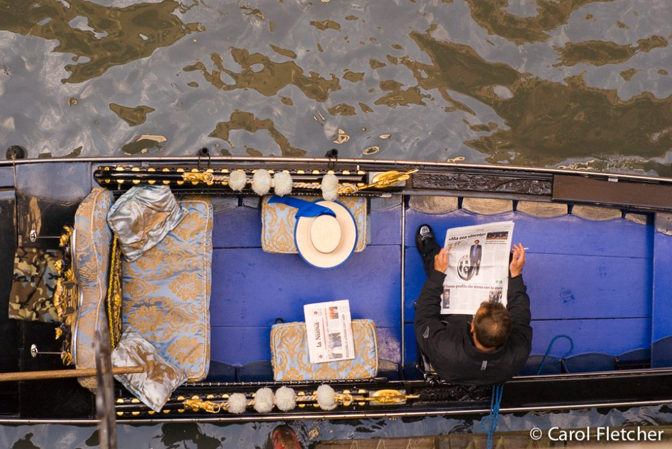 Looking down from our room: Gondolier waits