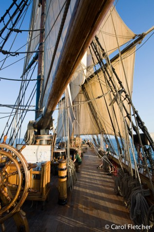 The wheel, deck and sails of the Bounty