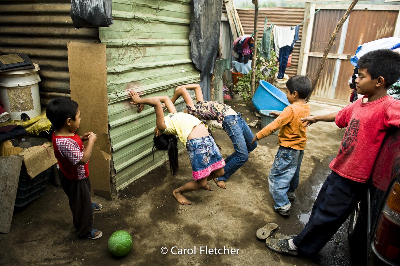 Guatemala kids playing backbends duenas