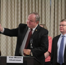Rep. Chuck McGrady, R-Henderson, answers a question on coal ash legislation as House Rule Committee Chair Tim Moore, R-Cleveland, looks on during a meeting on the bill, held Wednesday in Raleigh. Kirk Ross/Carolina Public Press