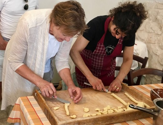 Learning to make orrecchiette (ear-shaped pasta).