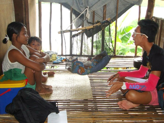 Teacher Janrell Berzabal interviews one of the mothers from Sitio Cagait