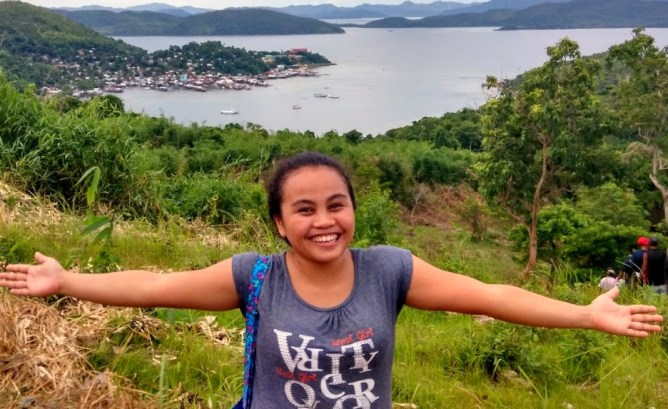 Arjane beams with joy in one of her first visits as a volunteer to Cartwheel's partner area in Culion, Palawan