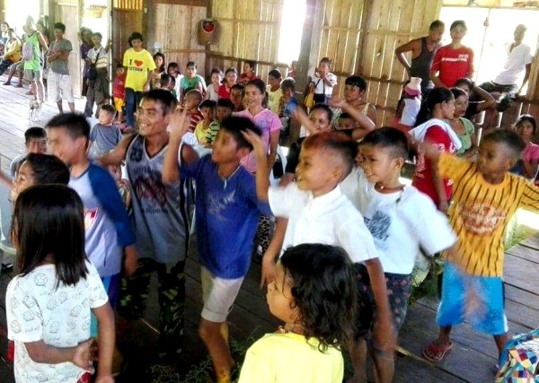 Early Childhood and Elementary Education (ECEE) students from the Higaonon community delight in performing a traditional dance for their parents and other community members during the school's recognition day.