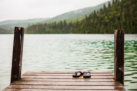 Flip flops on a Dock in front of a Turquoise Water Lake in the Wild Nature