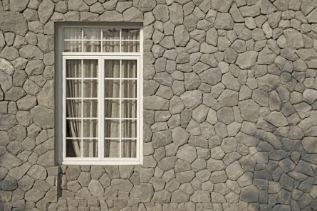 vintage window on stone wall background