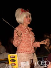 Barb Scheffler explaining what Mysteriously Yours... Mystery Dinner Theatre is all about and the services it can provide