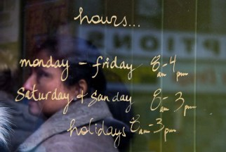 The hours that Lady Marmalade is open, artfully scrawled on its front door in Toronto, ON