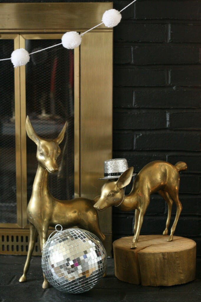 mantle brass deer with party hat and disco ball