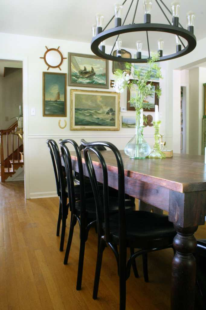 Black bentwoods in dining room, vintage nautical gallery wall