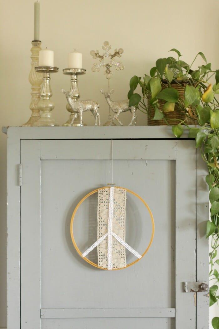 Peace Sign Wreath on Cabinet Door, vintage glitter deer and mercury glass