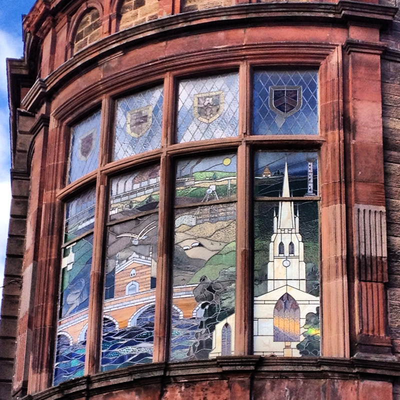 This preserved stained glass is on the Effingham Street corner of the Old Town Hall.