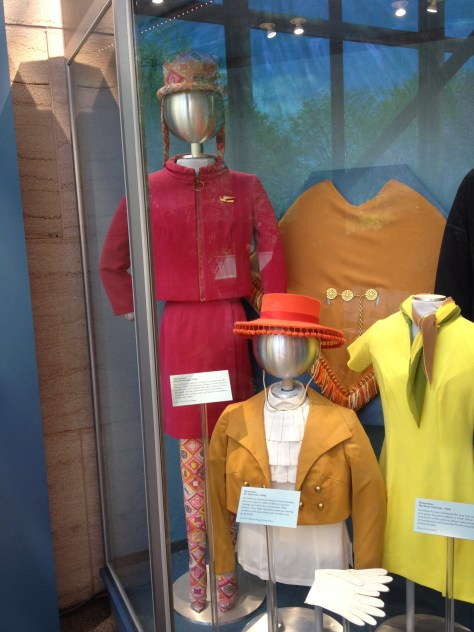 On the left, Braniff Airways stewardess uniform of 1965 designed by Emilio Pucci, in the middle Air California's stewardess uniform of the 1960s