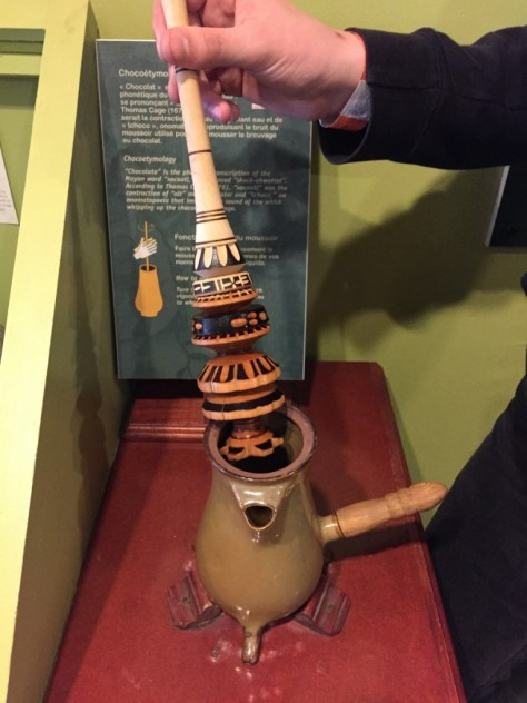 reproduction of a Mayan whisk used to whip chocolate into liquid form