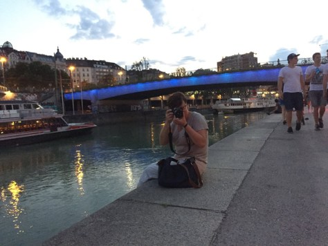 My sister taking a photo of me as I'm taking a photo of her on the bank of the Donaukanal
