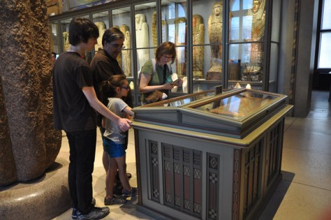 Casual Travelers looking at Egyptian artifacts at the Kunsthistorisches Museum in Vienna, Austria