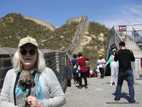 Carol from Travels with Carole at the Great Wall in China