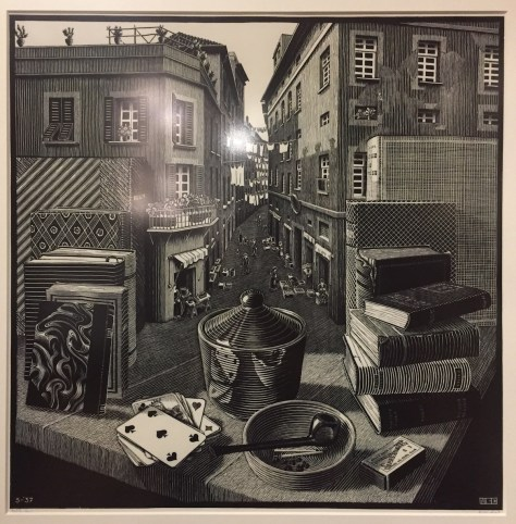 M.C. Escher's 1937 woodcut, Still life and street