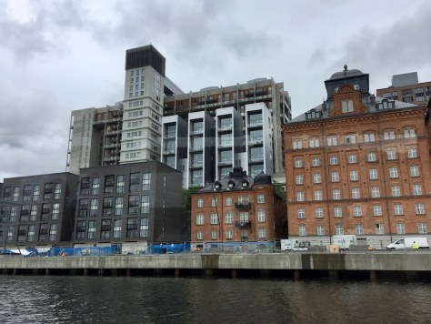 view from Stockholm shuttle ferry 80 onto buildings along Siloplatsen street on the southern shore of the city.