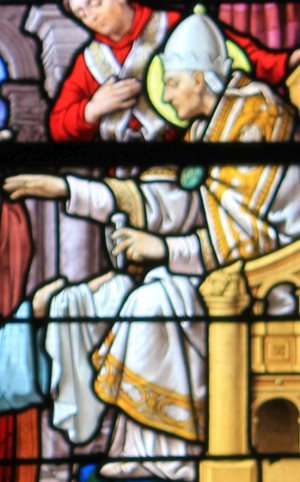 detail of a stained glass window showing Pope Saint Linus giving a nail from the cross of Saint Peter to Saint Clair of Rome; by Ch. Lorin of Chartres, 1905; Church of Saint-Clair, Réguiny, France; photographed on 1 November 2013 by XIIIfromTOKYO; swiped from Wikimedia Commons