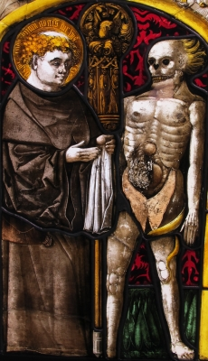 detail of a stained glass window of Saint Fridolin; date unknown, artist unknown; swiped from Wikimedia Commons