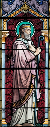 detail of a stained glass window of Saint Irenaeus; 1901 by Lucien Bégule; Church of Saint Irenaeus, Lyon, France; photographed on 6 June 2010 by Gérald Gambier; swiped from Wikimedia Commons; click for source image