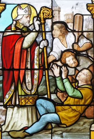 stained glass window depicting Saint Memmius of Châlons-sur-Marne healing, date and artists unknown; swiped from Wikimedia Commons
