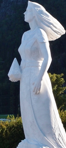 detail of a marble statue of Saint Sunniva of Selja; sculpture by Arne Meland, date unknown; harbour of Selje, Norway; photographed on 12 September 2015 by Atle Råsberg; swiped from Wikimedia Commons